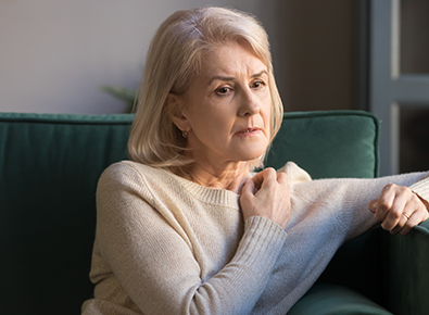 mature woman looking uncomfortable