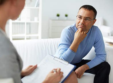 Man speaking with a therapist.