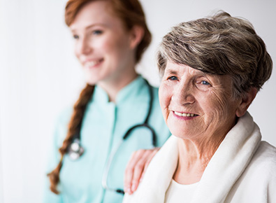 Home Health nurse supporting a patient.