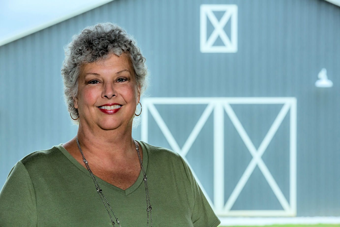 Carol Fulton in front of a barn