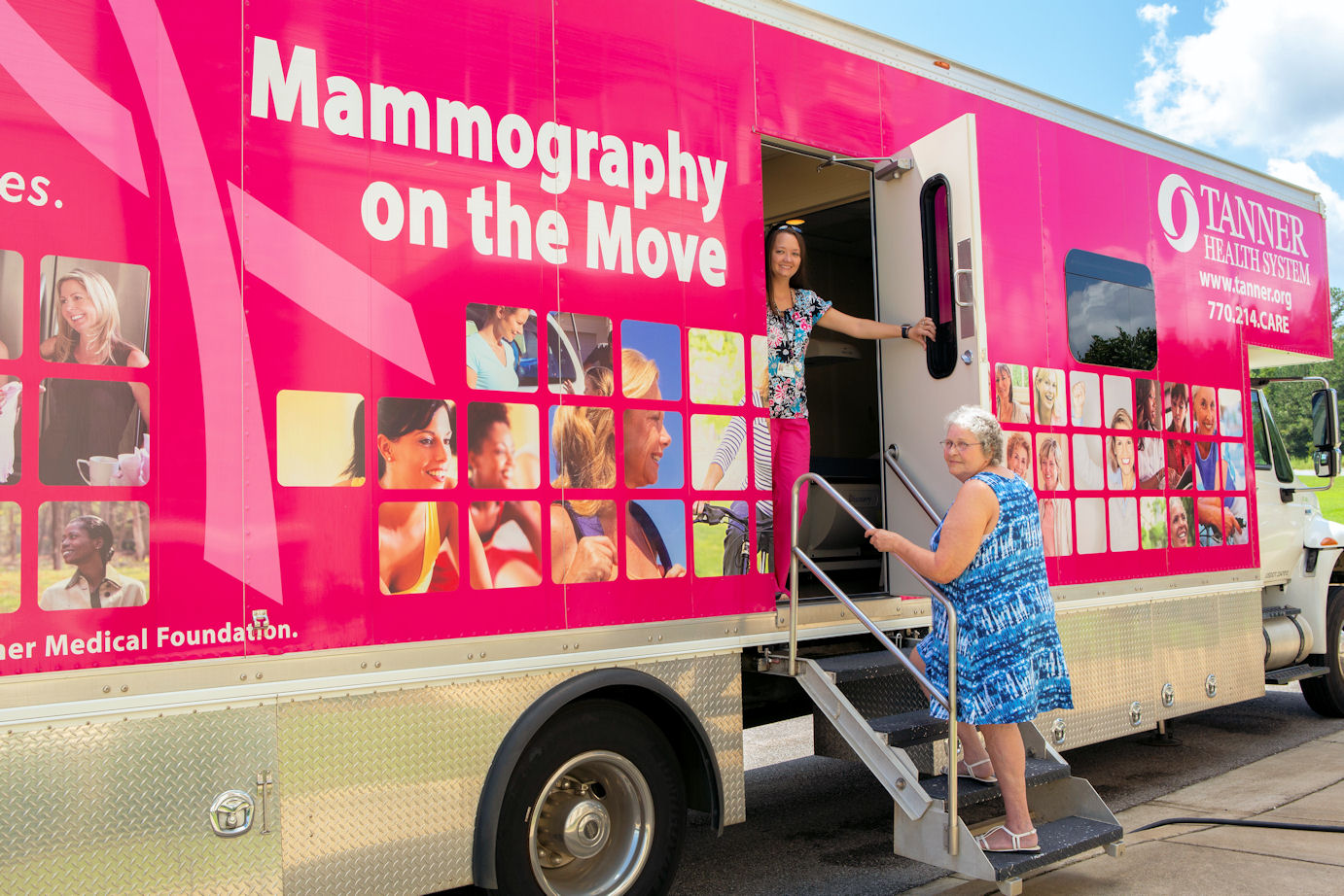 Elsie Wilson climbing about the mobile mammography unit