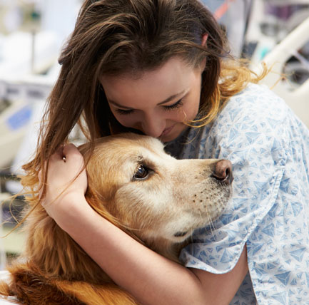 Female patient petting a dog.